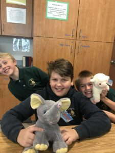 Boys stuffing bears for Our Childrens social change project