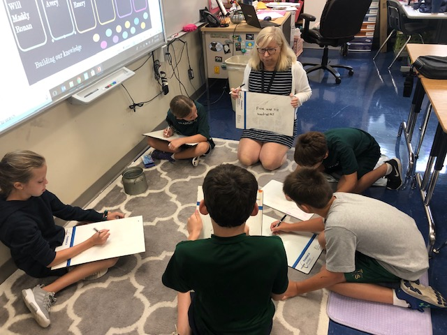 Students participating in a group discussion at The Franciscan School
