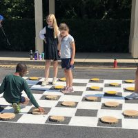 Four TFS Students playing Checkers Fun